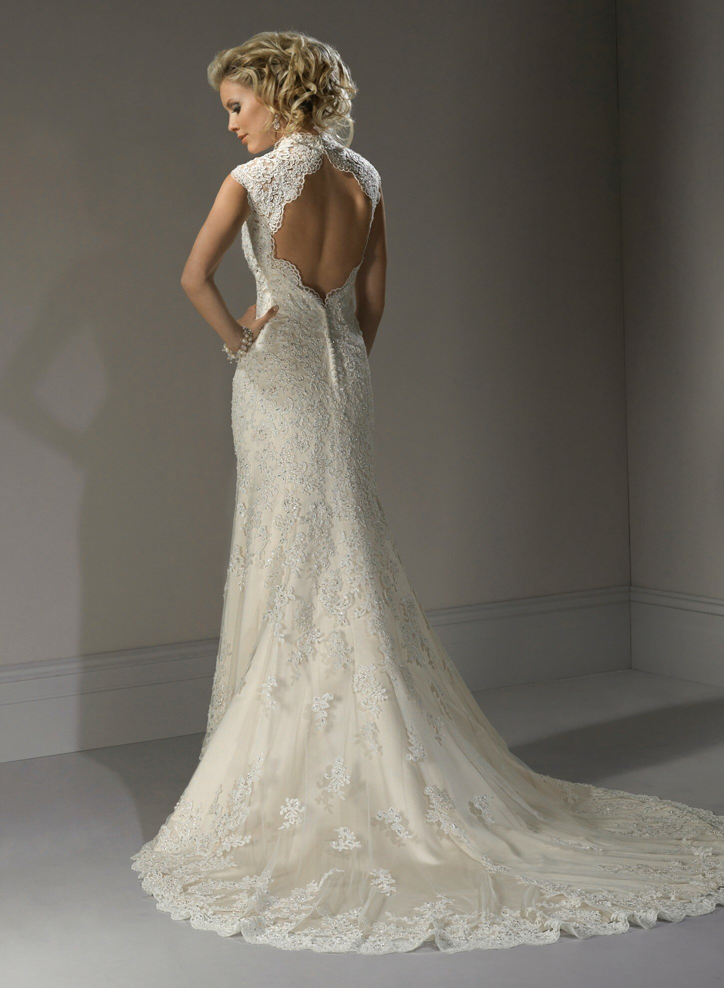 Wedding dresses with lace sleeves and open back Photo - 9